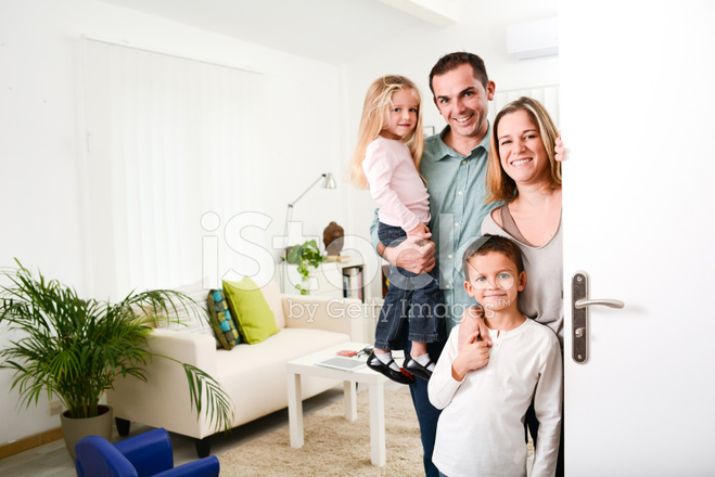 happy family with young kids welcoming guests at the door  sc 1 st  FreeImages.com & Happy Family With Young Kids Welcoming Guests AT The Door Stock ...