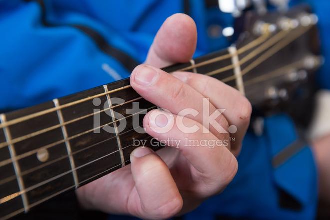 Hands Take Guitar Chords Stock Photos - FreeImages.com