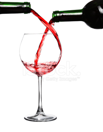 two bottles of red wine and one glass stock photos