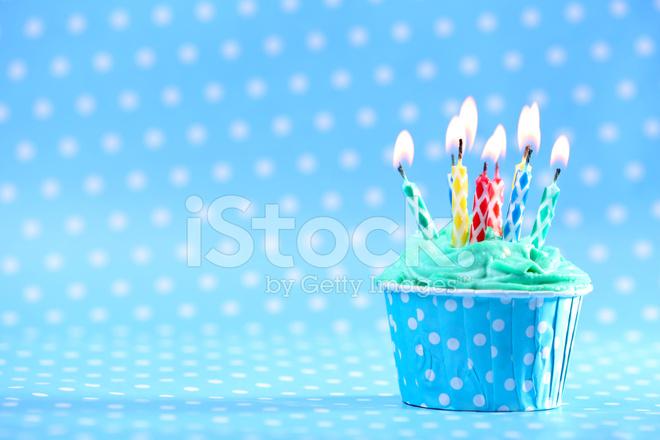 Delicious Birthday Cupcake on Blue Background Stock Photos