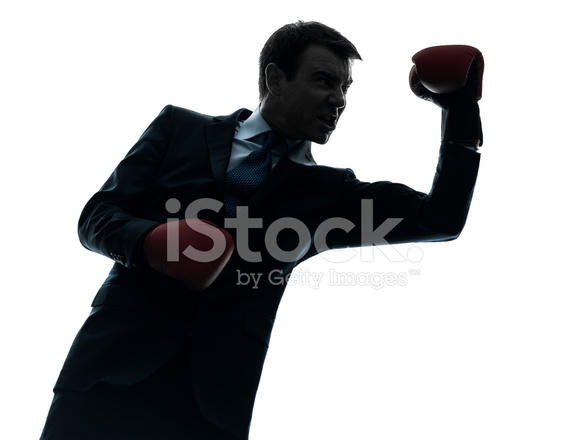 business man boxer with boxing gloves silhouette stock photos
