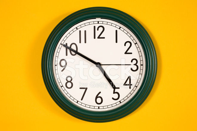 Wall Clock Showing 10 Minutes Until 5:00 Stock Photos