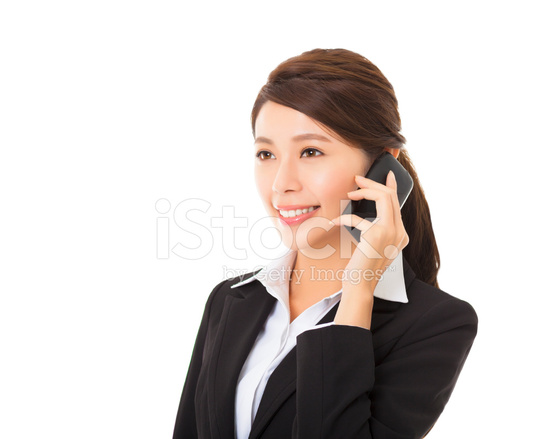 Happy Businesswoman Talking On The Mobile Phone Stock Photos