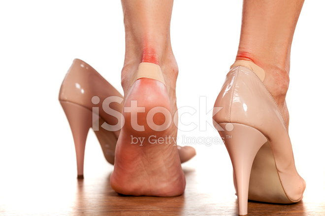 Closeup of Women's Heels With A Blister Plaster on Stock ...