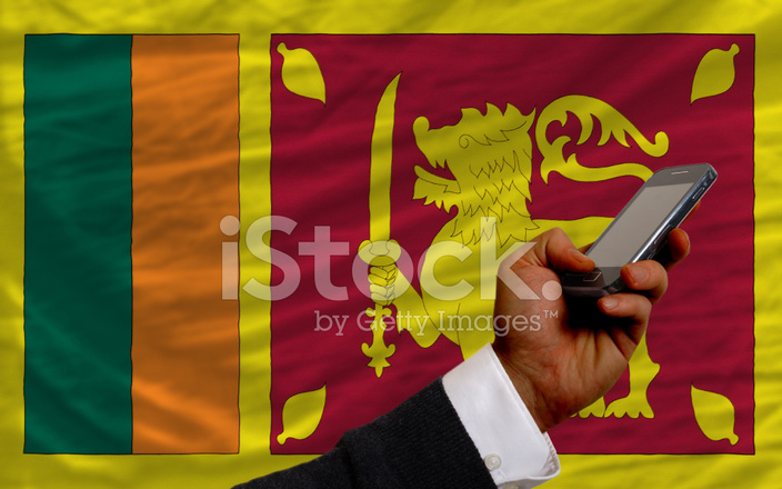 Cell Phone IN Front National Flag of Sri Lanka Stock Photos
