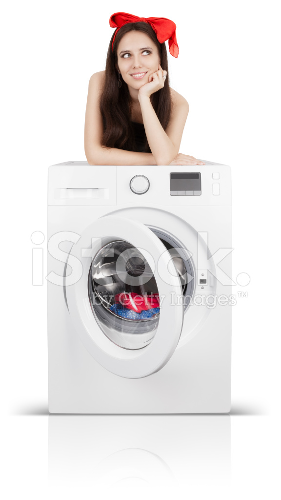 cute girl auf einer waschmaschine mit w sche gef llt stockfotos. Black Bedroom Furniture Sets. Home Design Ideas