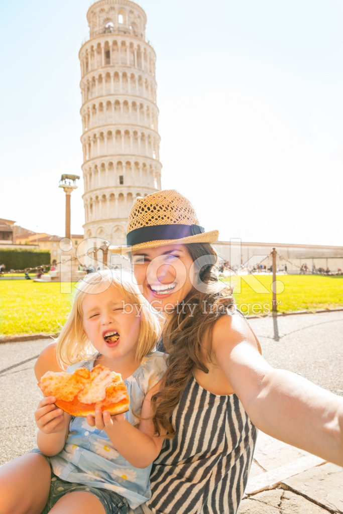 mother and baby girl making selfie near tower of pisa stock photos