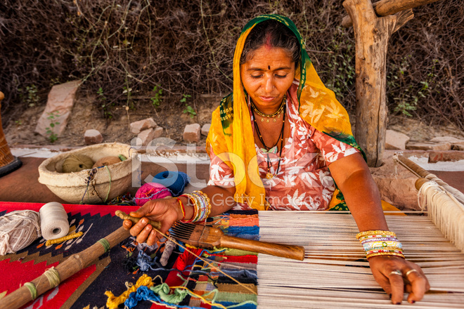 Indian Woman Weaving Textiles durry IN Rajasthan Stock