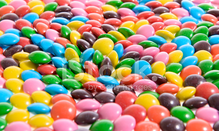 Fondos De Pantalla De Chocolates: 彩色背景甜美味夹心糖果 照片素材