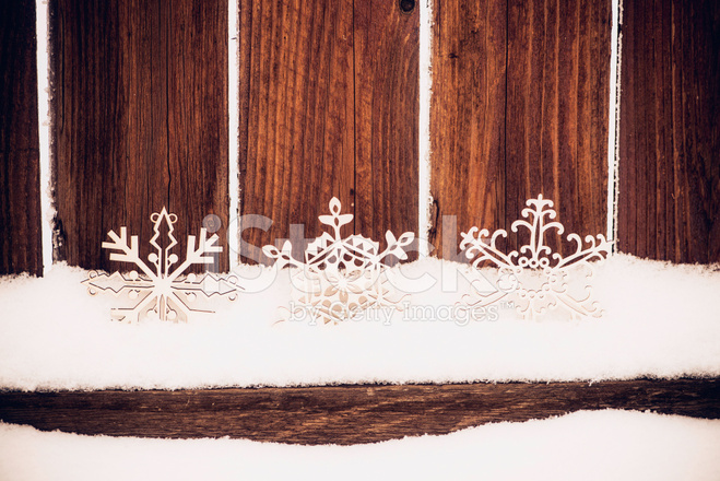 Winter Backgrounds Snowflakes On A Rustic Garden Fence Panel