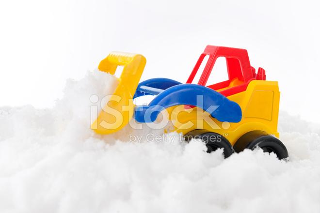 Spielzeug frontlader schöpft schnee stockfotos freeimages
