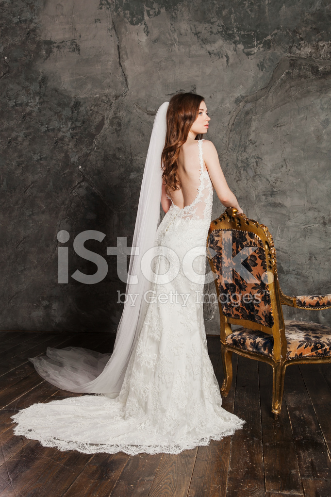 Back view of a beautiful sexy bride in luxurious wedding