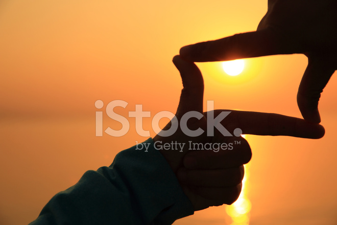 Hands Make A Frame Against Sunset AT Seaside Stock Photos ...