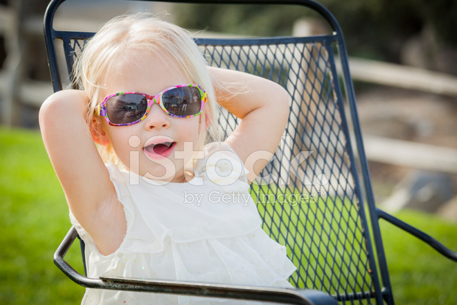 6dea143a5ecc Cute Playful Baby Girl Wearing Sunglasses Outside AT Park Stock ...
