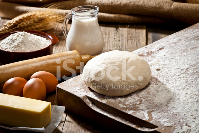 Pastry Board Over A Rustic Wooden Table With Baking Ingredients