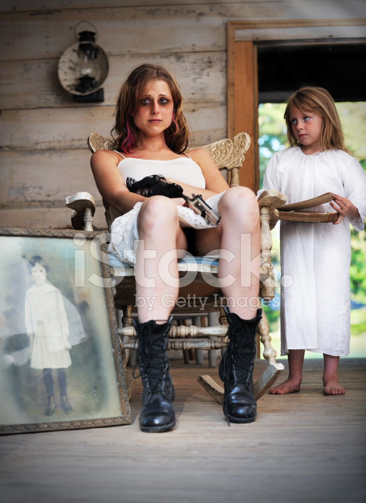 Sad Young Woman With Gun Beside Little Angel Girl Stock Photos