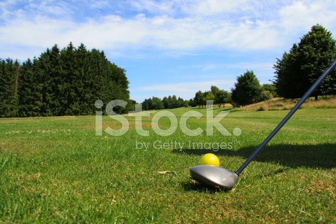 Golfball on tee stock photos for Fish food golf balls