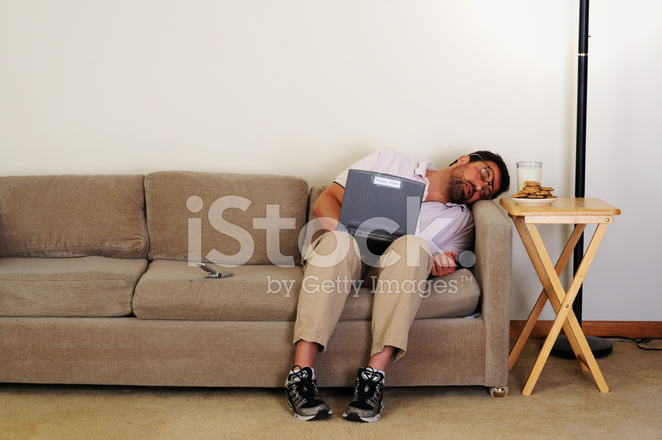 Computer Nerd Falls Asleep On Couch Stock Photos