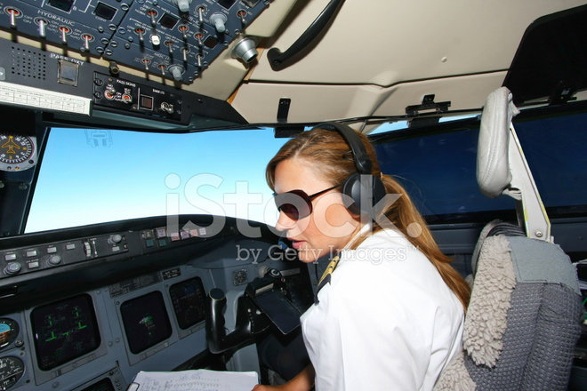 In Cockpit Of An Young Woman Pilot At Work Stock Photos