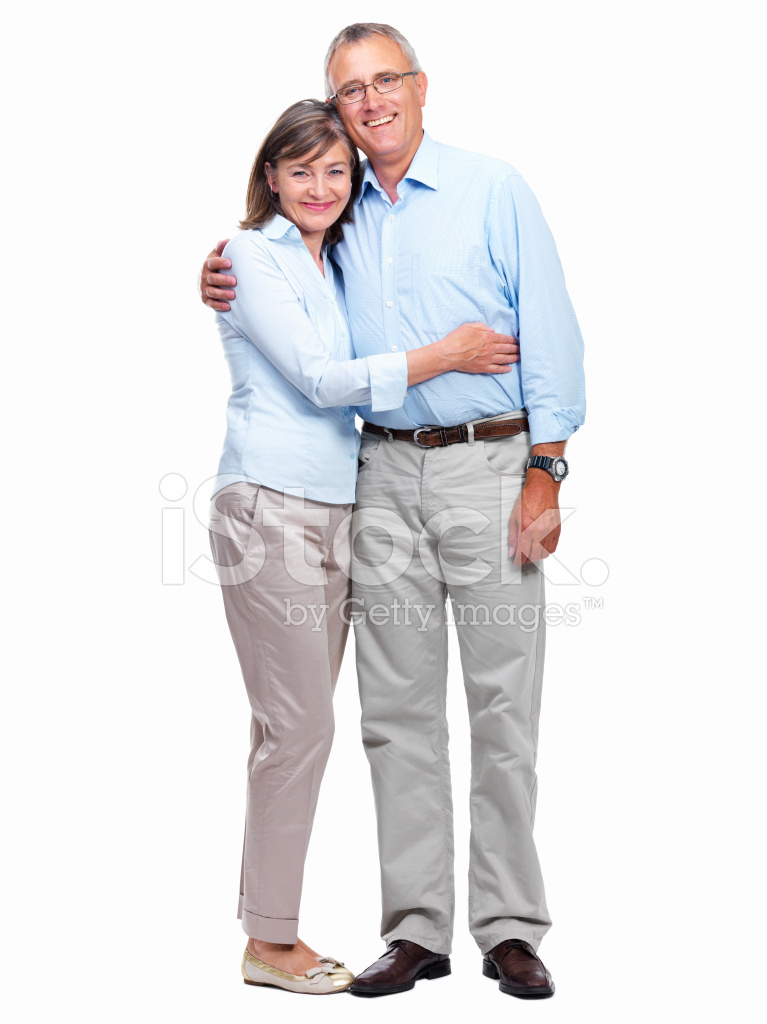 Happy Senior Couple Standing Together Against White