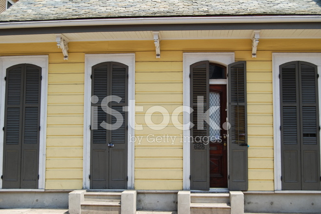 Yellow French Quarter House With Brown Shutters Stock Photos