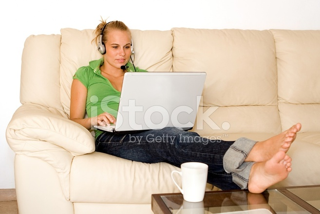 woman relaxing at home with laptop stock photos. Black Bedroom Furniture Sets. Home Design Ideas