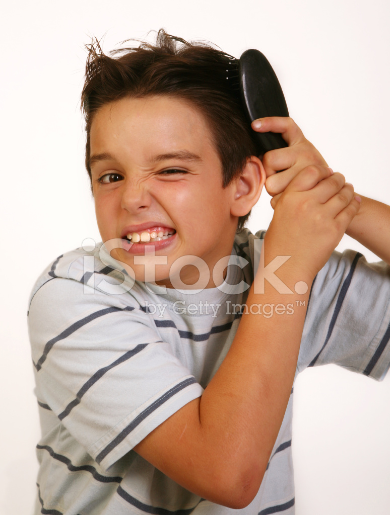 little boy brushing his hair stock photos freeimagescom