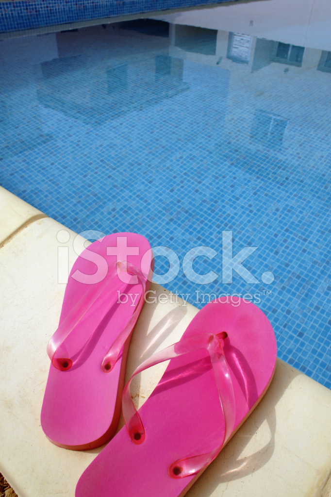 d59ecaa13677 Pink Swimming Pool Sandals on A Blue Water Background Stock Photos ...