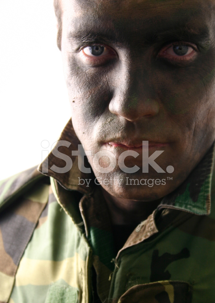 Man Wearing Camouflage Clothing And