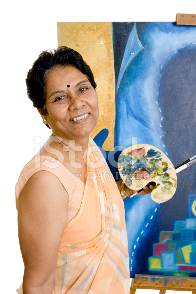 One Indian Senior Woman Artist Working On Her Painting Stock