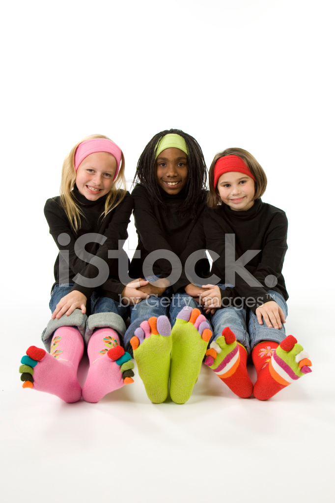 Ethnically Diverse Girls In Toe Socks Stock Photos