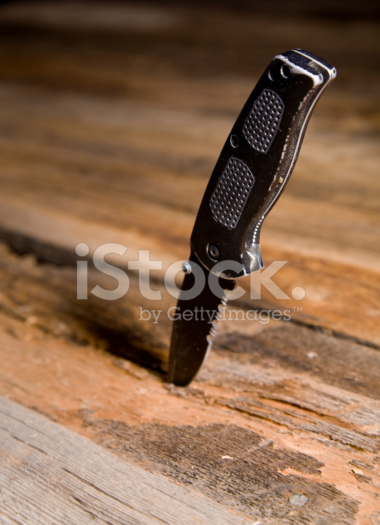 Knife Stuck IN Wood Stock Photos