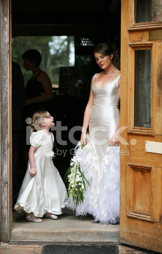 Bride With Flower Girl Smiling and Standing IN Door Frame Stock ...
