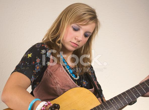 pretty blond girl plays guitar stock photos freeimages com