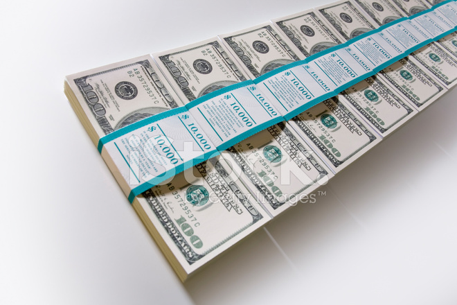 Bundles Of 100 Dollar Bills In A Row Stock Photos