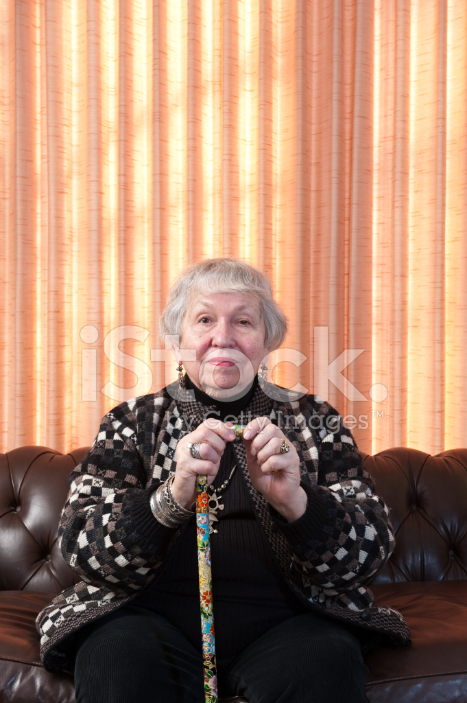 Old Woman Sitting On Sofa Curtain Behind Stock Photos
