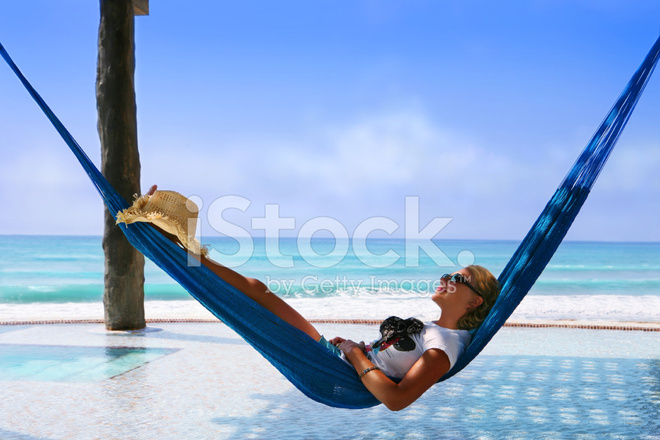 Woman Relaxing IN Infinity Pool Hammock Stock Photos