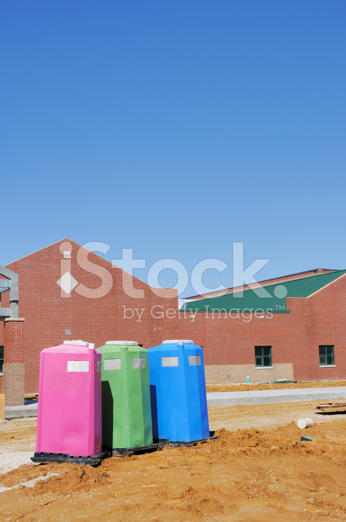 Construction Site Portable Toilets : Three portable toilet on construction site stock photos