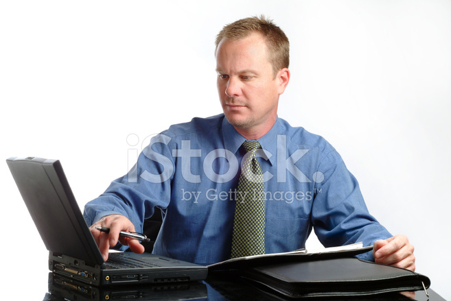 Businessman Working On His Laptop At His Desk Stock Photos