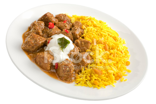 Indian Curry Pork Vindaloo With Basmati Rice On White Stock