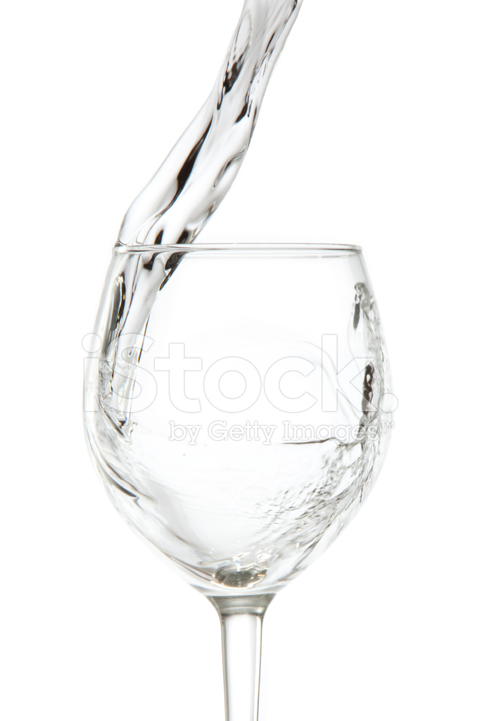 Water Being Poured Into A Wine Glass Stock Photos