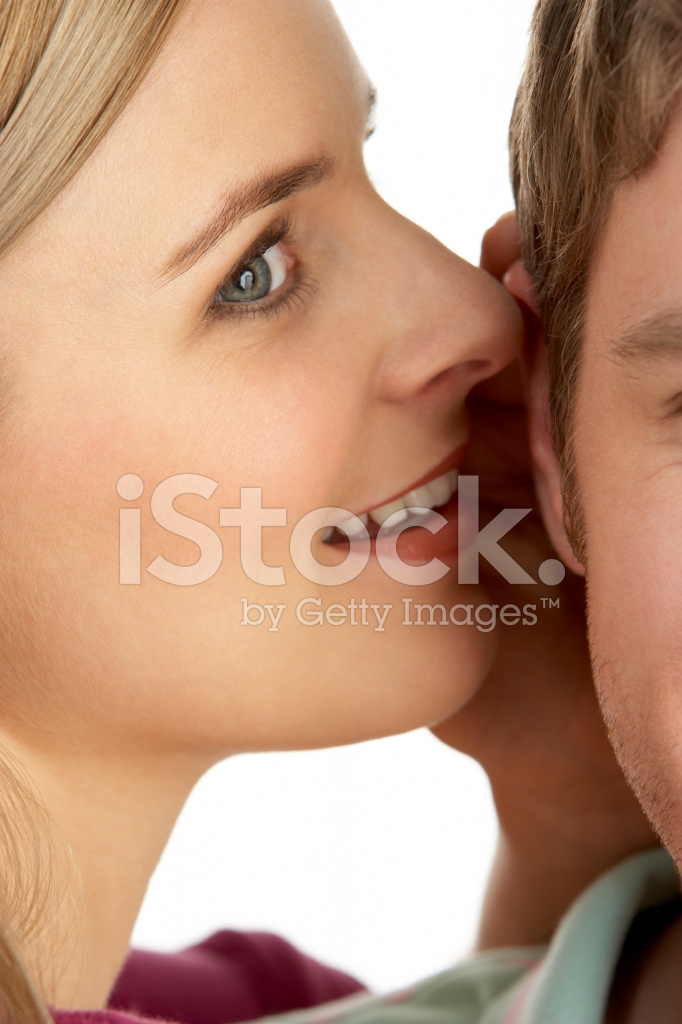 woman whispering into mans ear stock photos freeimagescom