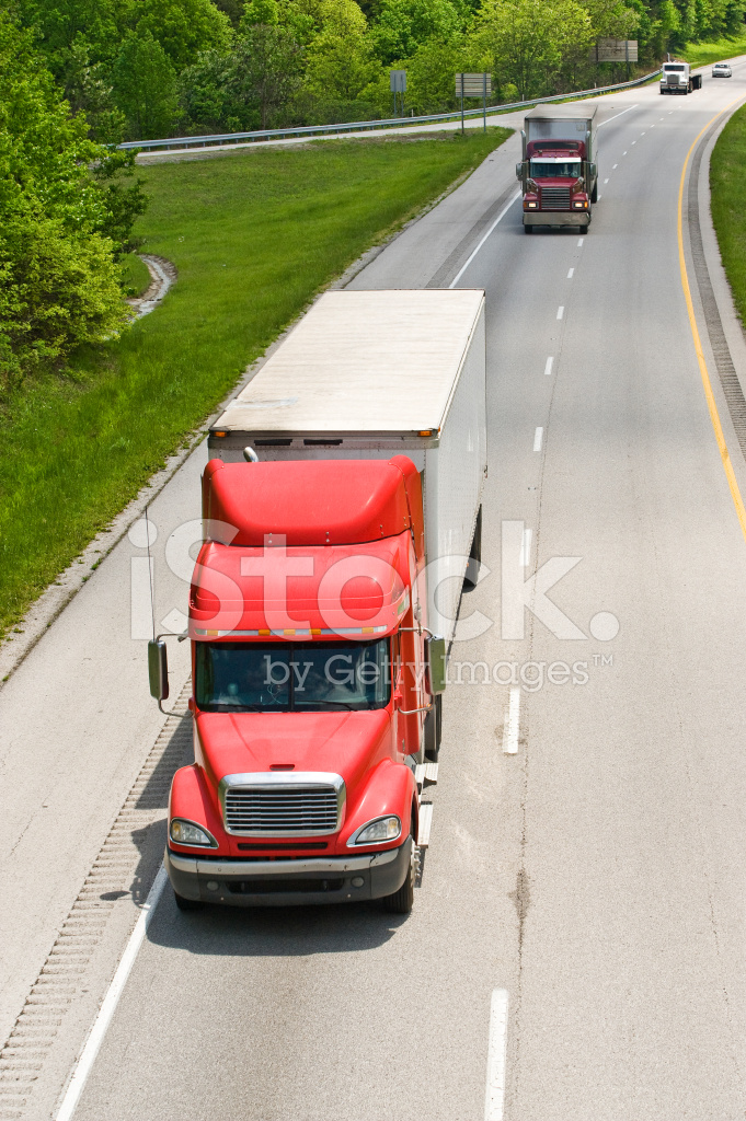 Vertical Photo Of Trucks On Interstate Highway Stock Photos