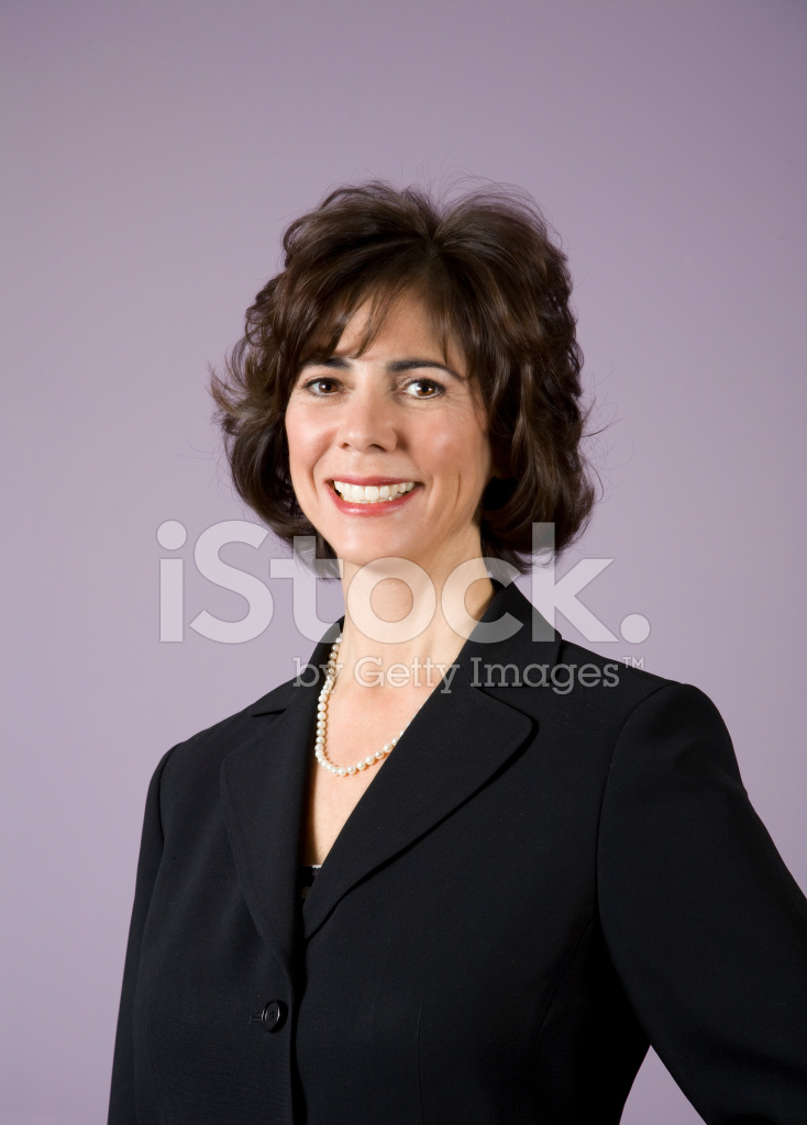 Smiling Mature Brunette Business Woman Against Lavender -7309