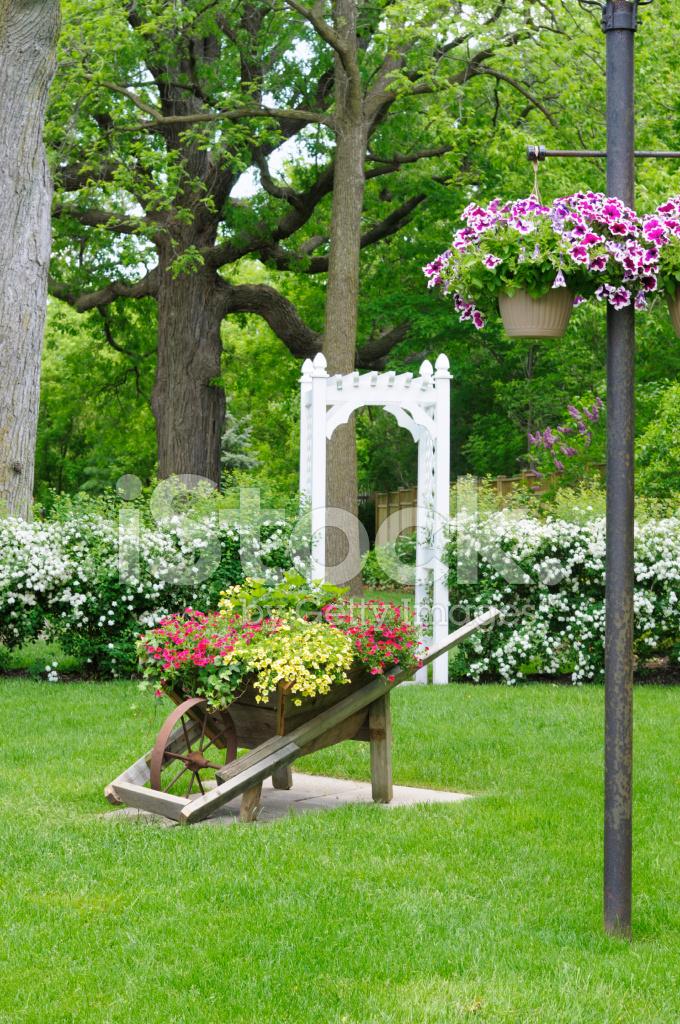 Beautiful Garden With Wheelbarrow Planter And Garden Arch