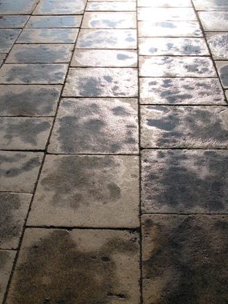 wet reflecting stone floor