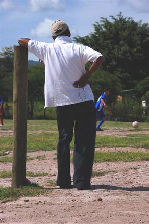 Elderly village man watching futbol