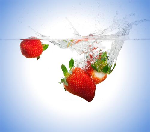 Strawberries fall under water