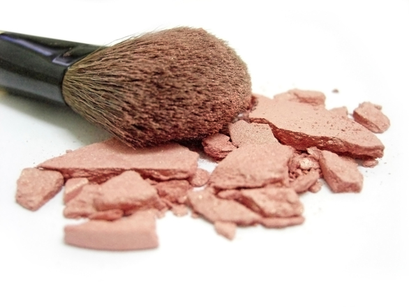 Broken blush and makeup brush
