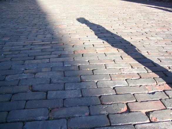 human shadow on brick